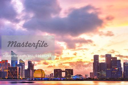 Dramatic sunset clouds over new skyscrapers of Hangzhou new business district, Jianggan (Qianjiang New Town), Hangzhou, Zhejiang, China, Asia