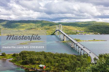 Green hills and turquoise sea frame the suspension road bridge in Tjeldsundbrua, Troms county, Nordland, Norway, Scandinavia, Europe