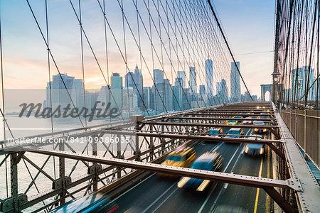Rush hour traffic on Brooklyn Bridge and Manhattan skyline beyond, New York City, United States of America, North America