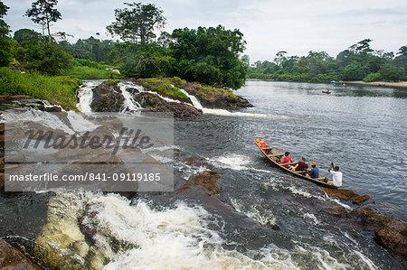 Tourist boat below the Lobe waterfalls, Kribi, Cameroon, Africa