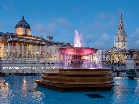 Trafalgar Square fountains and National Gallery at dusk, London, England, United Kingdom, Europe