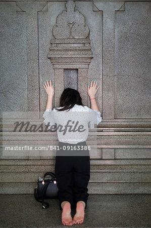 Worshipper praying at wall of the sanctuary, Mariamman Hindu Temple, Ho Chi Minh City, Vietnam, Indochina, Southeast Asia, Asia