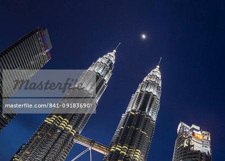 Petronas Twin Towers with the moon showing in between, Kuala Lumpur, Malaysia, Southeast Asia, Asia
