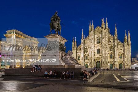 View of Duomo di Milano illuminated in Piazza Del Duomo at dusk, Milan, Lombardy, Italy, Europe