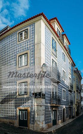 Traditional azulejo tiles on a building facade, Alfama, Lisbon, Portugal, Europe