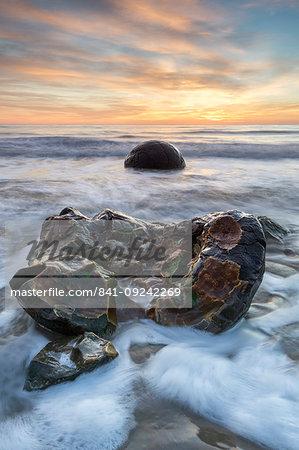 Exposed boulder at Moeraki Beach, Otago, South Island, New Zealand, Pacific