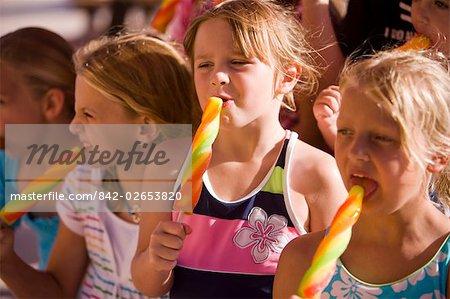 Group of children enjoying popsicles