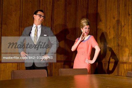 Vintage portrait of businesspeople in boardroom