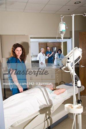 Healthcare worker preparing patient for procedure