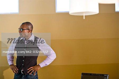 Casual African American businessman in boardroom