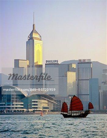 Hong Kong, Chinese junk sailing by Hong Kong Island skyline with Wanchai Tower.
