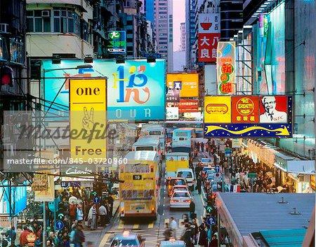 Hong Kong, Kowloon, evening traffic on Sai Yeung Choi Street in Mongkok.