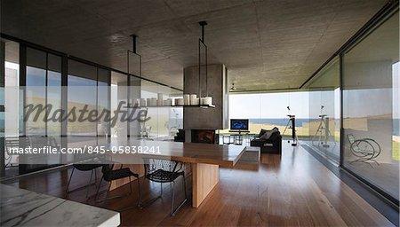 Open plan dining area with internal chimney, Flinders House, John Bornas, Melbourne, Victoria, Australia. Architects: John Bornas of Workroom