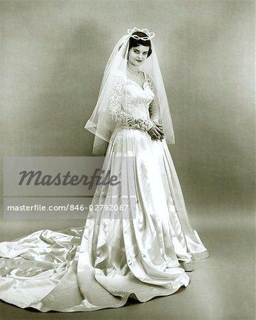 1950s FULL LENGTH PORTRAIT BRIDE STANDING WEARING WEDDING GOWN VEIL ...