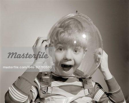 1950s PORTRAIT OF BOY WEARING BUBBLE HELMET