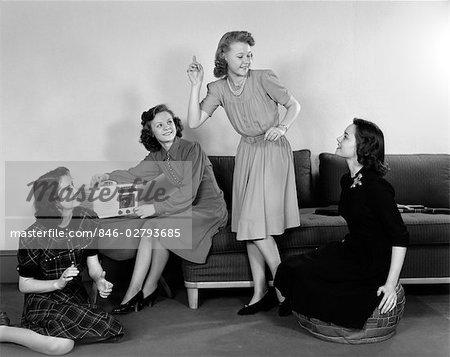 1940s FOUR TEEN GIRLS LISTENING TO MUSIC ON RADIO TALKING ONE GIRL DANCING