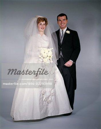 1960s FORMAL FULL LENGTH STUDIO PORTRAIT OF BRIDE AND GROOM - Stock ...