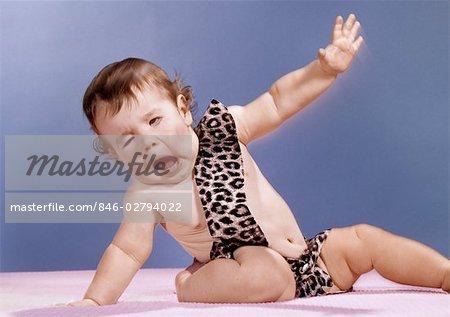 BABY IN LEOPARD SKIN TARZAN COSTUME WITH PECULIAR FACIAL EXPRESSION STUDIO BIZARRE - Stock Photo & BABY IN LEOPARD SKIN TARZAN COSTUME WITH PECULIAR FACIAL EXPRESSION ...