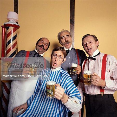 1970s FOUR MEN BARBERSHOP QUARTET SINGING HOLDING MUGS OF BEER
