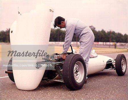 1960s 1970s MAN MECHANIC HOOD UP WHITE SPORTS RACE RACING CAR WORK WORKING ON ENGINE
