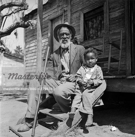 1930s ELDERLY MAN GRANDFATHER SIT PORCH SHACK WITH GRANDSON BOY