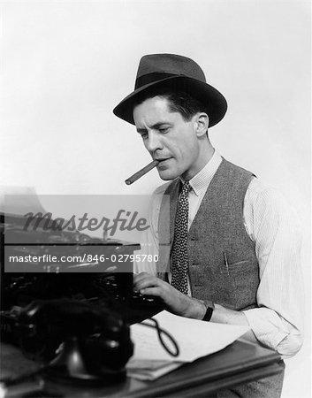 1930s MAN NEWSPAPER REPORTER WEARING HAT TYPING SMOKING CIGAR