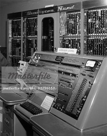 1950s HAND ON CONTROL PANEL OF REMINGTON RAND UNIVAC COMPUTER