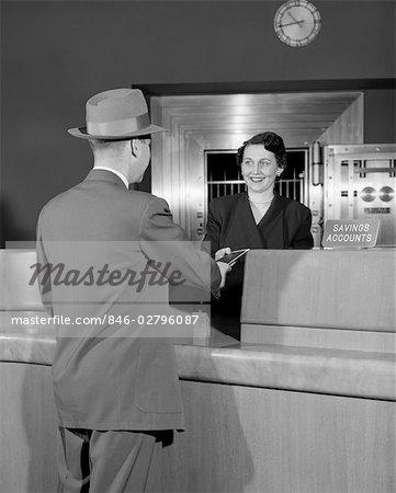 1950s MAN WOMAN TELLER BANK FINANCE HAT SUIT SERVICE SMILE MONEY