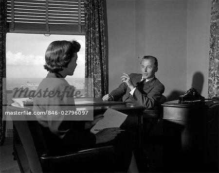 1950s MAN WOMAN SECRETARY BOSS TELEPHONE DESK PAPERWORK