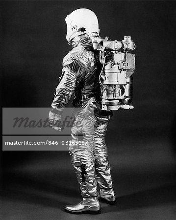 1960s SIDE VIEW OF ASTRONAUT WEARING HELMET NASA SPACE SUIT