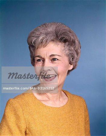 1960s PORTRAIT SMILING ELDERLY WOMAN WEARING ORANGE TOP