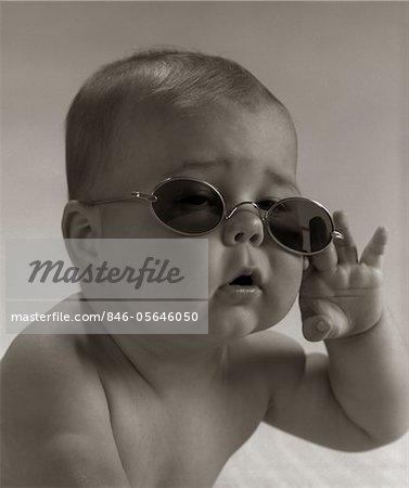 1960s BABY WEARING GRANNY GLASSES SUNGLASSES