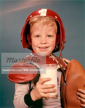1960s Blond Boy Smiling Wearing Red Helmet Football Shoulder Pads