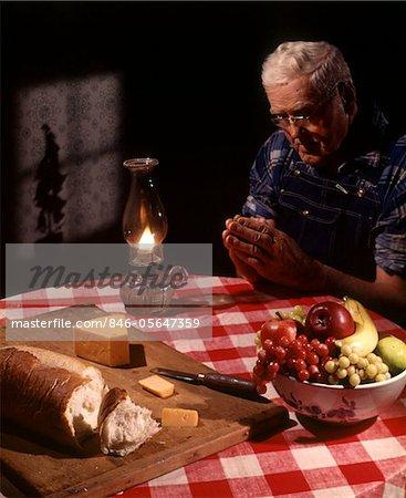 1960s Senior Elderly Man Praying Saying Prayer Thanksgiving Table