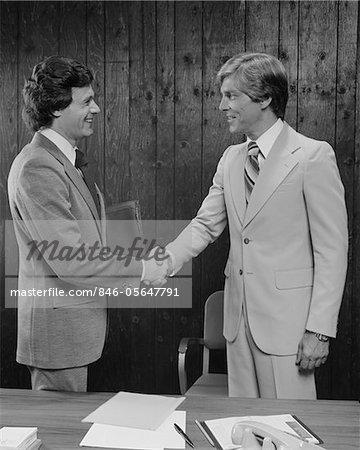 1970s - 1980s TWO BUSINESSMEN SHAKING HANDS HANDSHAKE
