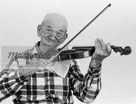 1960s ELDERLY MAN PLAYING VIOLIN LOOKNG AT CAMERA
