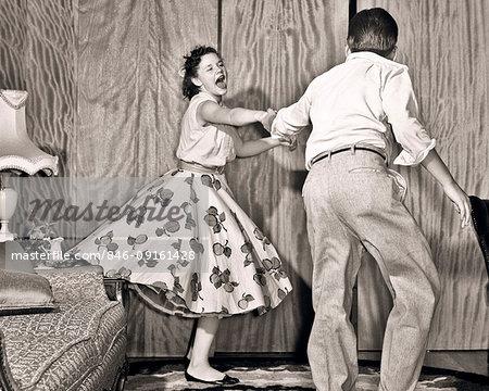 1950s TEENAGE COUPLE BOY AND GIRL DANCING ROCK AND ROLL JITTERBUG