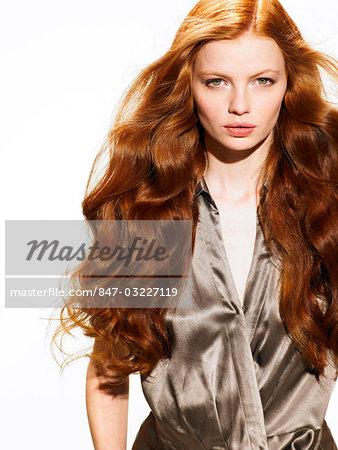 Wavy redhead woman in silk shirt