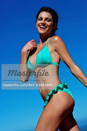 Beautiful brunette running on the beach