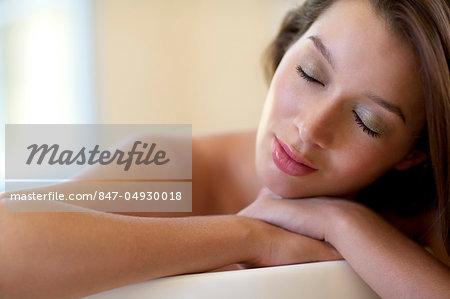 Beautiful brunette relaxing in the bath
