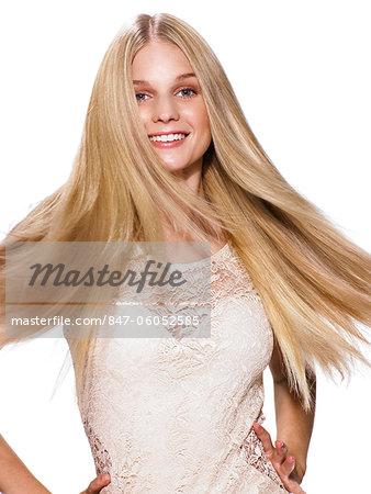 Beautiful blonde girl shaking her hair