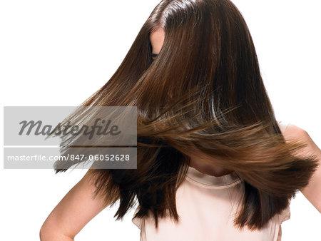 Beautiful brunette shaking her hair
