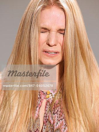 Beautiful blonde looking frustrated
