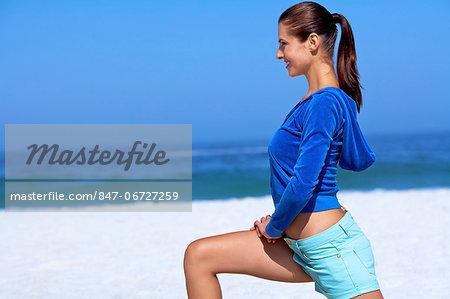 Beautiful brunette warming up on beach