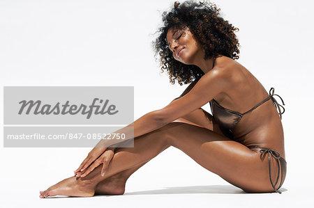 Body shot of afro-caribbean woman in a bikini