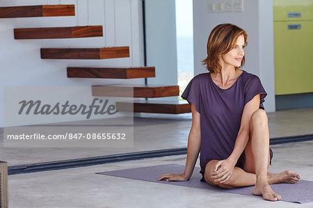 Beautiful mature woman relaxing after exercising.