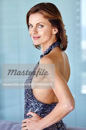 Portrait of beautiful mature woman in blue sequin dress.