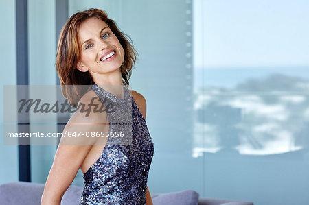 Beautiful mature woman in blue sequin dress.