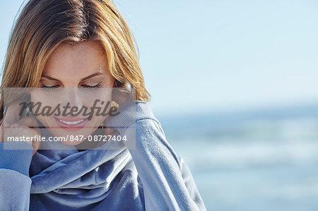 Portrait of beautiful mature woman in blue comfy jumper.