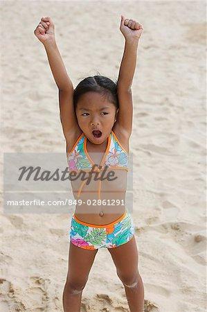 Girl raising arms and shouting